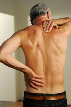A man with mid-back and rib pain